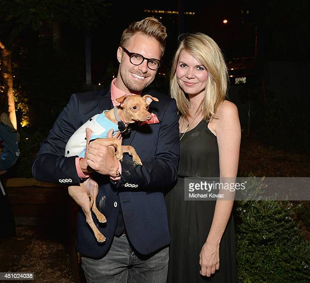 Photographer Seth Casteel Courtney Dasher and dog Tuna enjoy the 'More Than a Cone' art auction and campaign launch benefiting Best Friends Animal...
