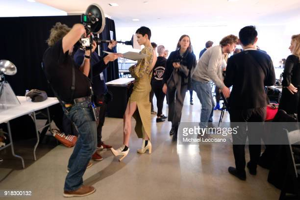 Photographer shooting modes preparing backstage for Esteban Cortazar during New York Fashion Week The Shows at Gallery I at Spring Studios on...