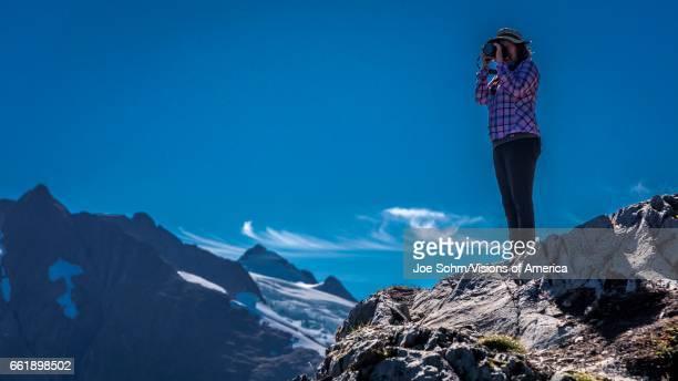 Photographer shooting pictures near Portage Glacier Alaska