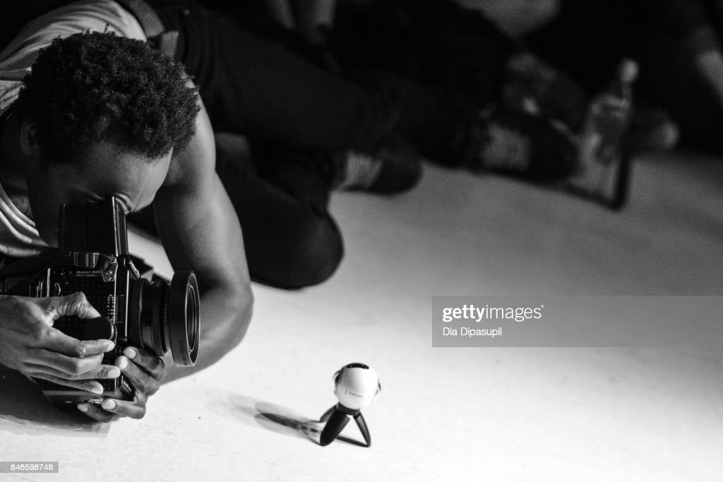 A photographer shoots the runway at the Zang Toi fashion show during New York Fashion Week: The Shows at Gallery 3, Skylight Clarkson Sq on September 13, 2017 in New York City.