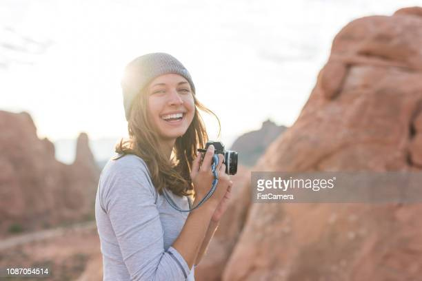 photographer shoots the sunrise in the utah wilderness - moab utah stock photos and pictures
