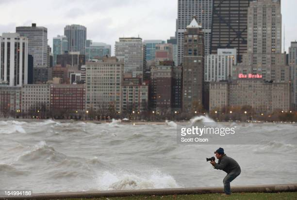 A photographer shoots waves generated from the remnants Hurricane Sandy as they crash into the shoreline of Lake Michigan on October 30 2012 in...