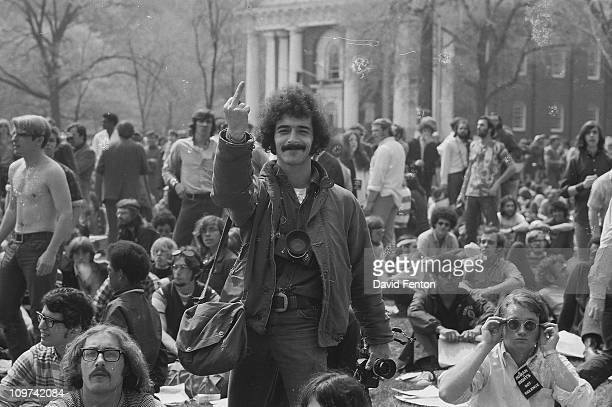 Photographer shows his displeasure by giving 'the finger' during a demonstration on the New Haven Green across the street from Yale University's...