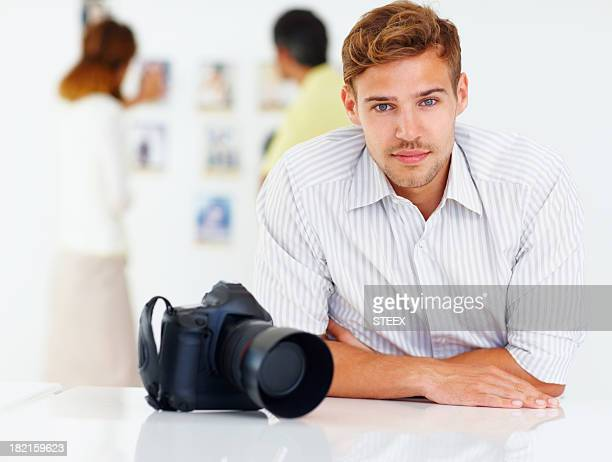 Photographer sitting at a table