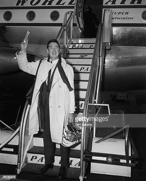 Photographer Slim Aarons arrives by plane circa 1955