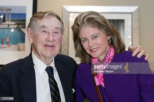 Photographer Slim Aarons poses with Maria Cooper Janis at the Slim Aarons Exhibition/Book Release Party at the Staley Wise Gallery November 6, 2003...