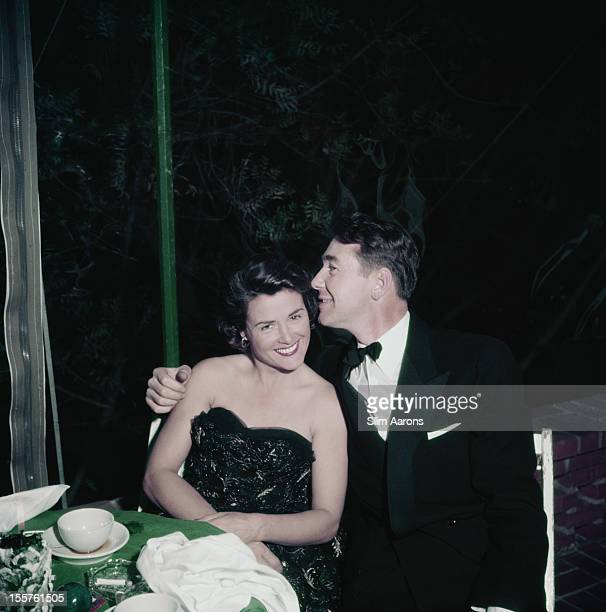 Photographer Slim Aarons with his arm around a woman at a Christmas Eve party in Beverly Hills California USA 24 December 1951 The party was held at...