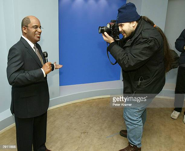 A photographer snaps a picture of the Do The Weather With Al experience wax figure at Madame Tussauds New York January 29 2004 in New York City