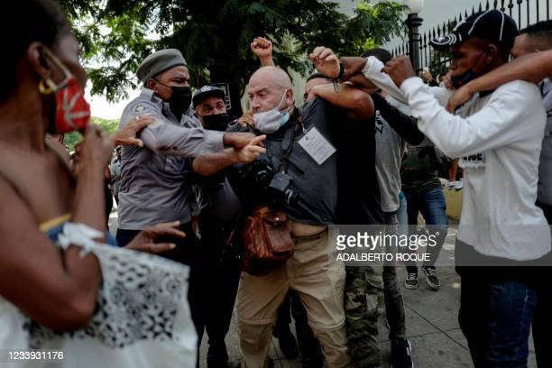 Photographer, Spanish Ramon Espinosa, is attacked by the police while covering a demonstration against Cuban President Miguel Diaz-Canel in Havana,...