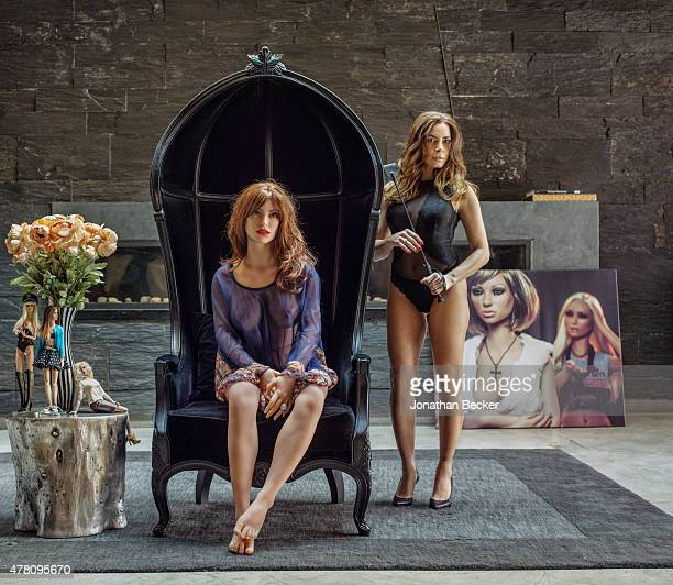 Photographer Stacy Leigh is photographed with one of her RealDolls for Vanity Fair Magazine on March 6 2015 at home in New York City PUBLISHED IMAGE