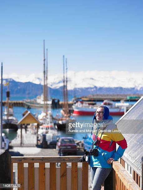 Photographer standing on wooden dock