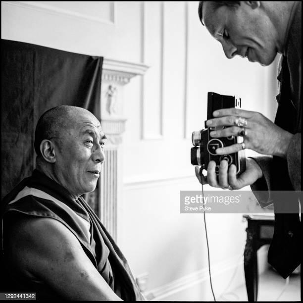 Photographer Steve Pyke working with Tenzin Gyatso, the 14th Dalai Lama, during a photo shoot, circa 1996.