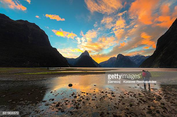 A photographer take a photo in the sunset time at Milford Sound