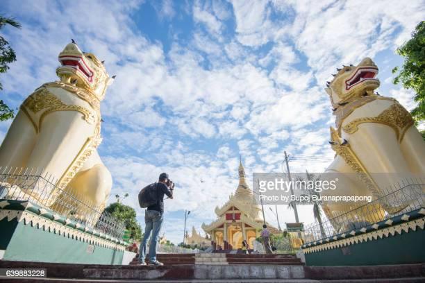 Photographer take photo of Maha Wizaya Pagoda in Dagon Township, Yangon, Myanmar