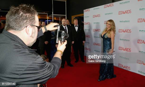 A photographer takes a photo of adult film actress/director Stormy Daniels as she attends the 2018 Adult Video News Awards at the Hard Rock Hotel...