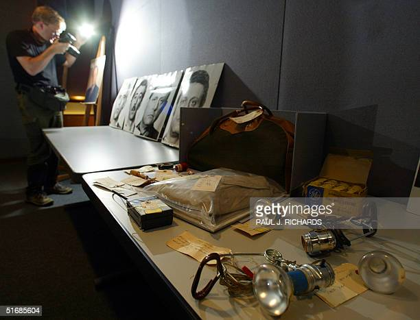 A photographer takes a photo of evidence from the infamous Watergate breakin at the Democratic National Committee headquarters at the Watergate...