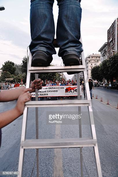 A photographer takes a photo of the demonstration while climbing up in a ladder Demonstrations organized by Workers Militant Front school teachers...