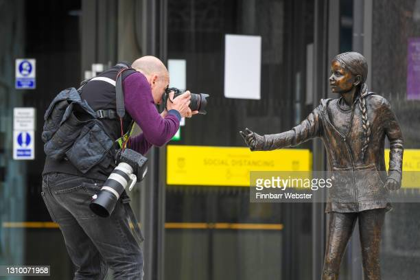 Photographer takes a photo of the Greta Thunberg statue on March 31, 2021 in Winchester, England. The school's student union was critical of the...
