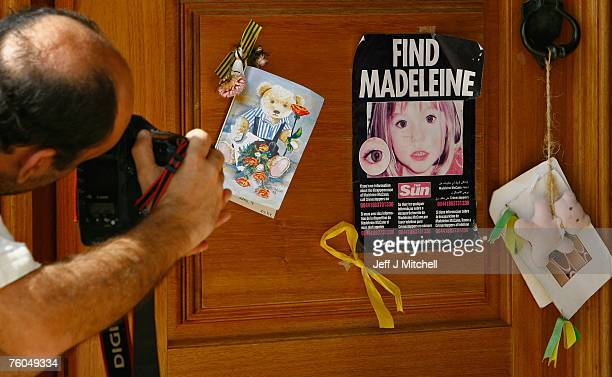 A photographer takes a photograph of a poster and cards placed on the Church door in Praia da Luz for missing Madeleine McCann August 10 2007 in...