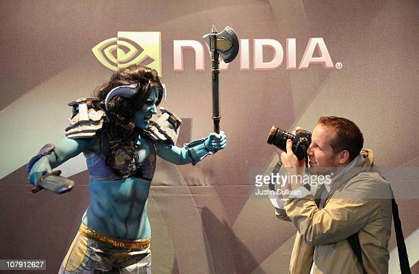 A photographer takes a photograph of a video game character in the Invidia booth during the 2011 International Consumer Electronics Show at the Las...