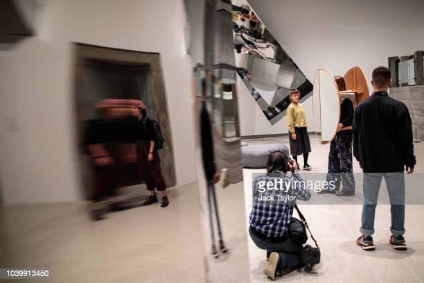 A photographer takes a photograph of 'Interactive Abstract Bodies ' 2012 by Josiah McElheny during a media preview for the Space Shifters exhibition...
