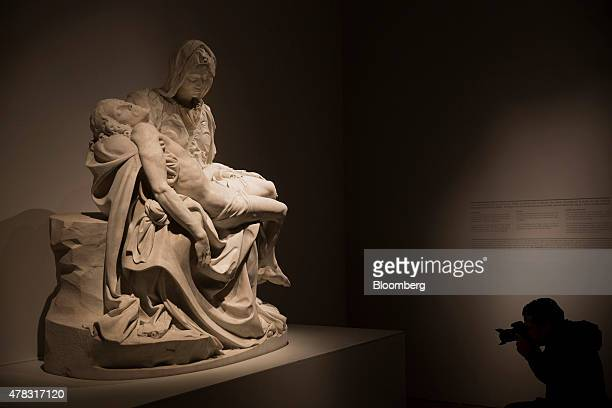 A photographer takes a photograph of the La Pieta sculpture by Michelangelo Buonarroti on display at the Palacio de Bellas Artes in Mexico City...