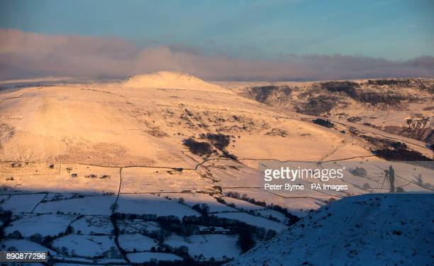 A photographer takes a picture near Mam Tor in Derbyshire's Peak District as Britain had its coldest night of the year with vast swathes of the...