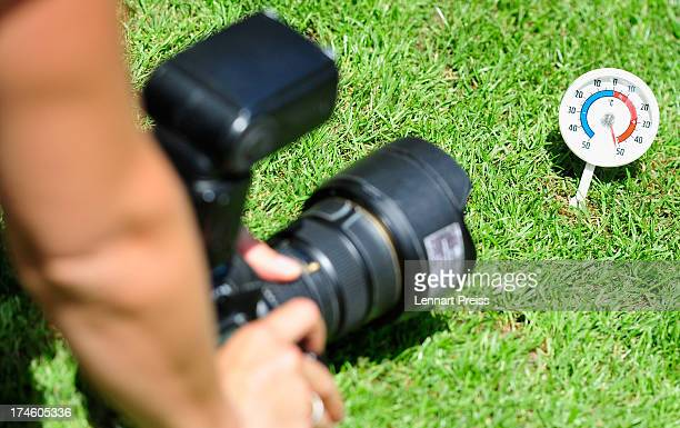 A photographer takes a picture of a thermometer standing next to the pitch before the 2 Bundesliga match between TSV 1860 Muenchen and FSV Frankfurt...
