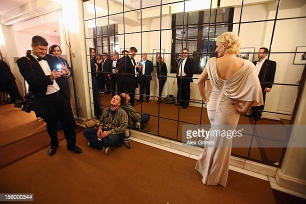 A photographer takes a picture of actress Eva Habermann during the 31 Sportpresseball at Alte Oper on November 10 2012 in Frankfurt am Main Germany