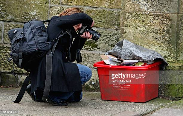 A photographer takes a picture of recyclable waste outside the Edinburgh home of the former chief executive of Royal Bank of Scotland Sir Fred...