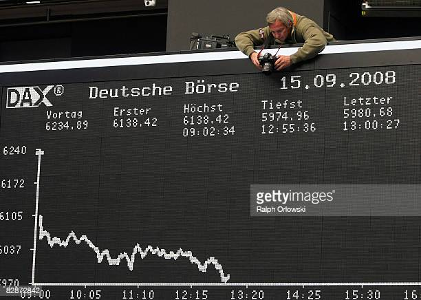A photographer takes a picture of the DAX Index board during a trading session at Frankfurt stock exchange on September 15 2008 in Frankfurt Germany...
