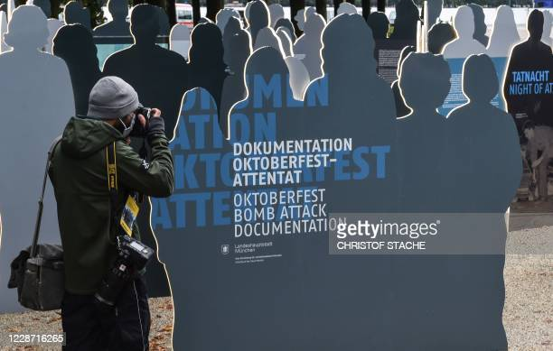 A photographer takes a picture of the documentation exhibition of the Oktoberfest attack during 40th anniversary memorial event of the Oktoberfest...