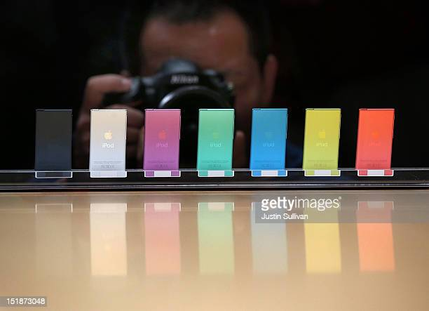 A photographer takes a picture of the new iPod Nano during an Apple special event at the Yerba Buena Center for the Arts on September 12 2012 in San...