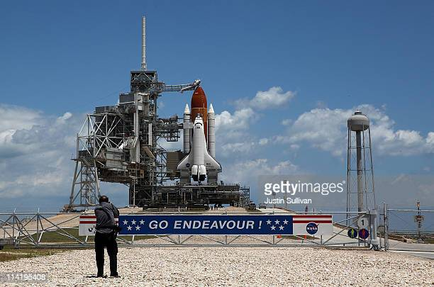 A photographer takes a picture of the space shuttle Endeavour as it sits on launch pad 39A at the Kennedy Space Center on May 15 2011 in Cape...
