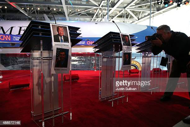 A photographer takes a picture of the stage before the start of the CNN Republican Presidential Debate at the Ronald Reagan Presidential Foundation...