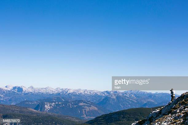 A Photographer Takes a Picture, Shots of a Magnificent Beauty of Nature View Against Blue Sky