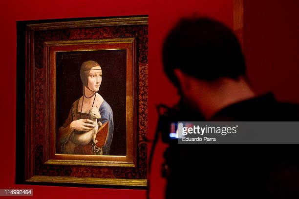A photographer takes photographs of 'Lady with an Ermine' painted by Leonardo Da Vinci as it is displayed in the collection 'Polonia Tesoros y...