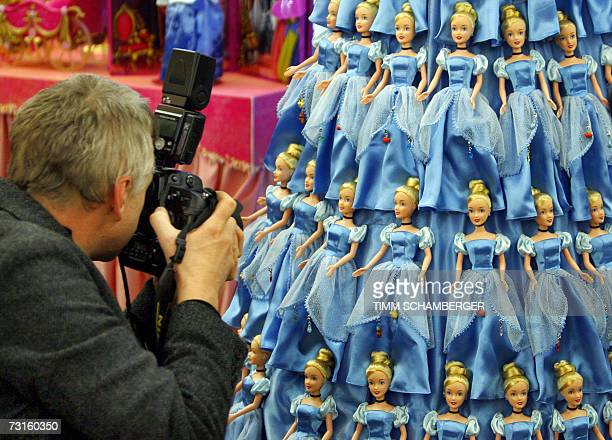 A photographer takes photos of dolls named Disney Princess Golden Glitter' 31 January 2007 at the International Toy Fair in Nuremberg southern...