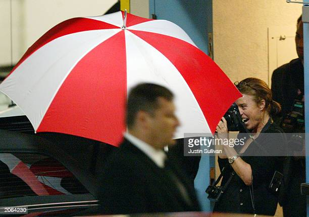 A photographer takes photos of model Christy Turlington and actor Edward after their wedding at Saints Peter and Paul Church Burns June 7 2003 in San...