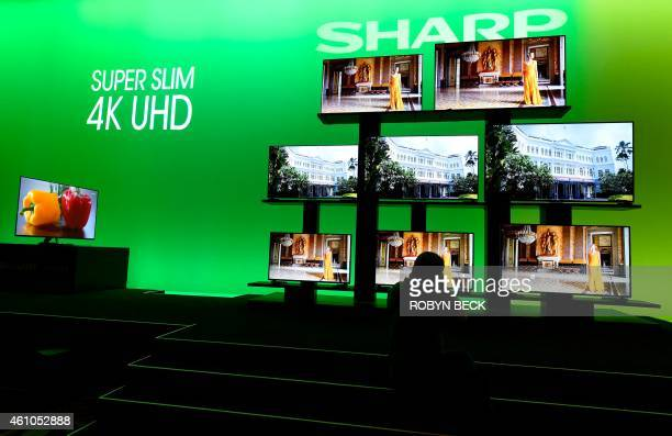 A photographer takes photos of the Sharp Super Slim 4K UHD televisions on display at the Sharp press conference at 2015 Consumer Electronics Show in...