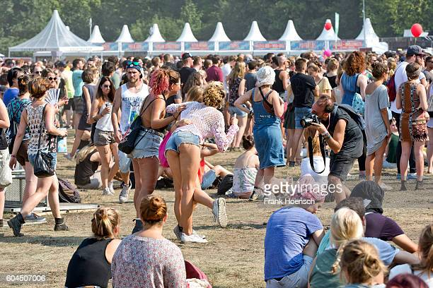 A photographer takes photos of visitors during the second day of Lollapalooza Festival at the Treptower Park on September 11 2016 in Berlin Germany
