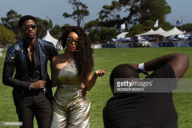 Photographer takes picture of a couple posing prior to the start of the Met horse race, one of the richest horse races on the African continent, at...