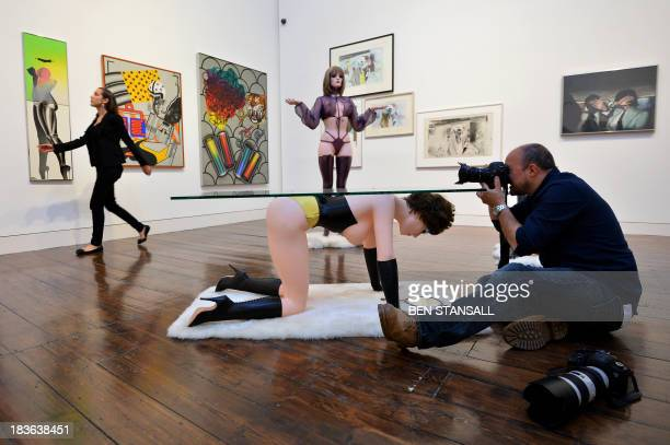 Photographer takes pictures during a photocall for an exhibition entitled 'When Britain Went Pop' at Christie's auction house in London, on October...