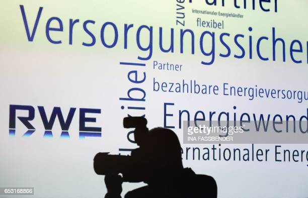 A photographer takes pictures during the annual results press conference of German energy supplier RWE on March 14 2017 in Essen western Germany /...