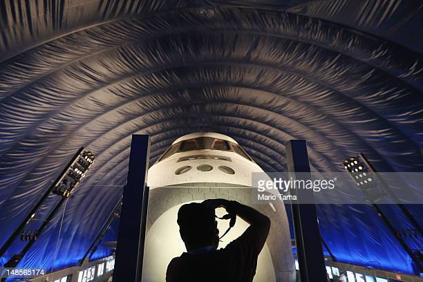 A photographer takes pictures in front of The Space Shuttle Enterprise at a press preview of the Intrepid Sea Air Space Museum's new Space Shuttle...