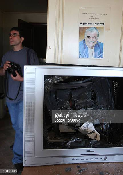A photographer takes pictures of a damaged office in the Hariri familyowned AlMustaqbal newspaper building after fire swept over one of its floors...