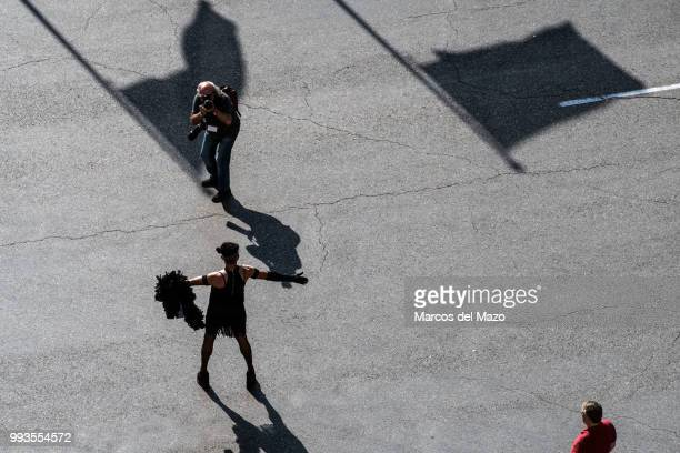 A photographer takes pictures of a reveller during the Gay Pride 2018 parade
