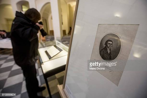 A photographer takes pictures of the cantata 'Per la Ricuperata Salute di Offelia' created by composers Wolfgang Amadeus Mozart and Antonio Salieri...