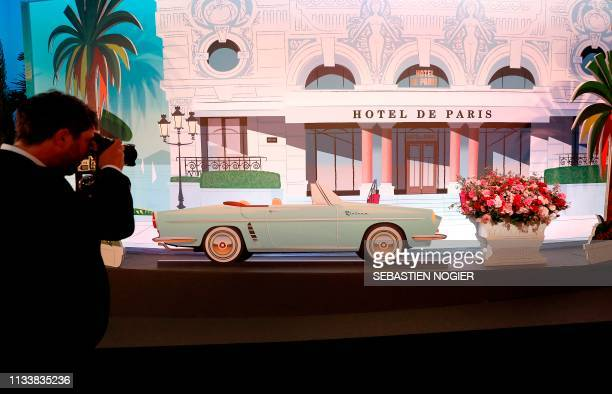 A photographer takes pictures of the decor at the 'Bal de la Rose' in Monaco on March 30 2019 The Rose Ball is a traditional annual charity event in...