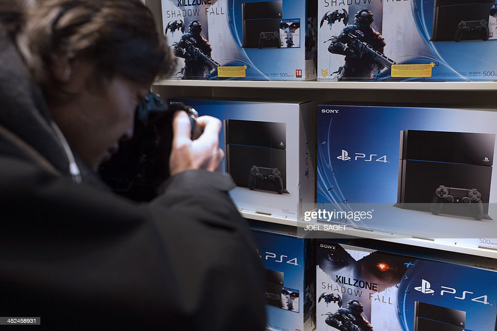 A photographer takes pictures of the new Sony Playstation 4 video game console (PS4) during its presentation on November 29, 2013 in a store in Paris.